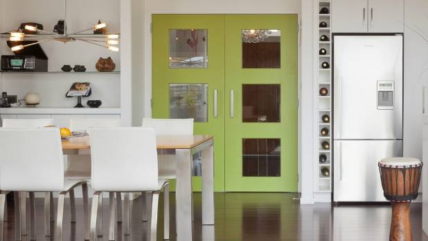 Block colour accents will continue to enliven our living spaces this year. The doors in this kitchen are painted in ...