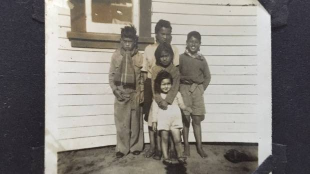 An old photo from the album of Harvey Karaitiana. Harvey is in the middle at the rear of this photo, with his younger ...