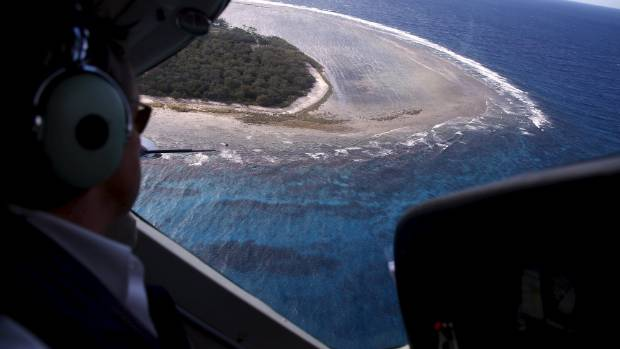 Pilot John Peaker prepares to land on Lady Elliot Island located north-east of the town of Bundaberg.