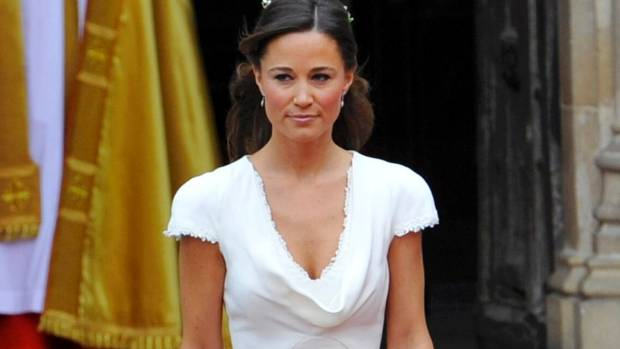 Pippa Middleton wore a head-turning cowl neck dress with cap sleeves to her sister's wedding.