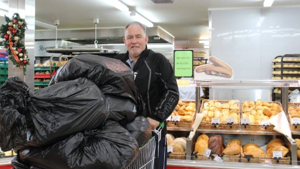 Breakfast Club founder Steven Farrelly collects donated bread from New World Eastridge for the Christmas store.