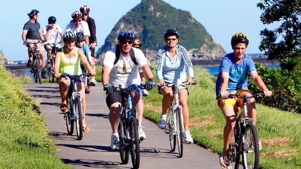 Cyclists enjoying the New Plymouth Coastal Walkway.