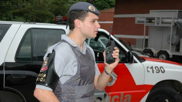 A Sao Paulo police officer uses a Tait Communications portable radio. The 2016 Rio de Janeiro Olympics have increased ...