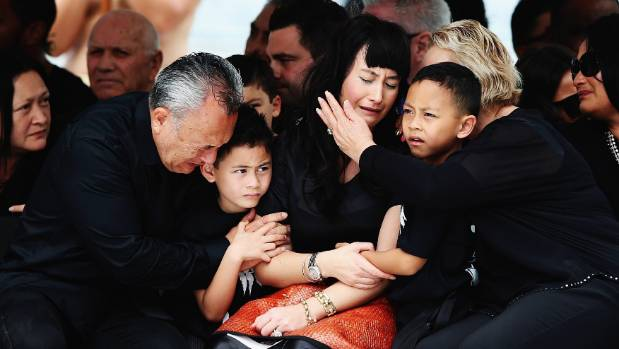 Widow of Jonah Lomu, Nadene Lomu is comforted by her two sons Brayley Lomu and Dhyreille Lomu, her mother Lois Kuiek and ...