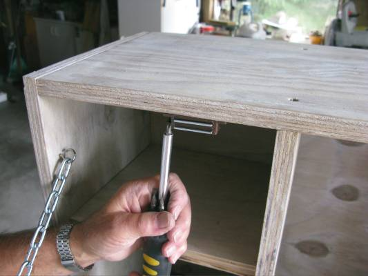 Step 8: Fix magnetic catches in place. Attach handle to front of cabinet and touch up stain if necessary. Hang on wall ...