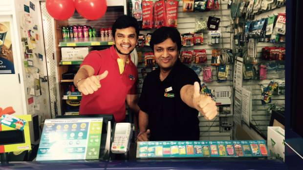 Dipak Dubariya (right) and Nimesh Bhavsar at Eastside Four square and Lotto, where the $15 million winning ticket was bought.