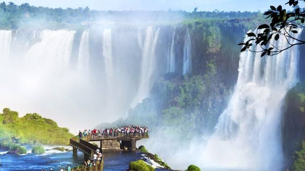 Brazil's Iguazu Falls, which has more than 200 individual waterfalls and can be viewed via helicopter, on foot, or by raft.