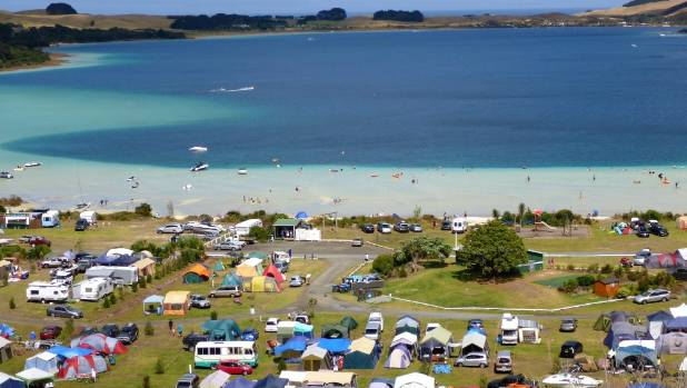 Holiday makers enjoy the Pine Beach camping ground at the Kai Iwi Lakes.
