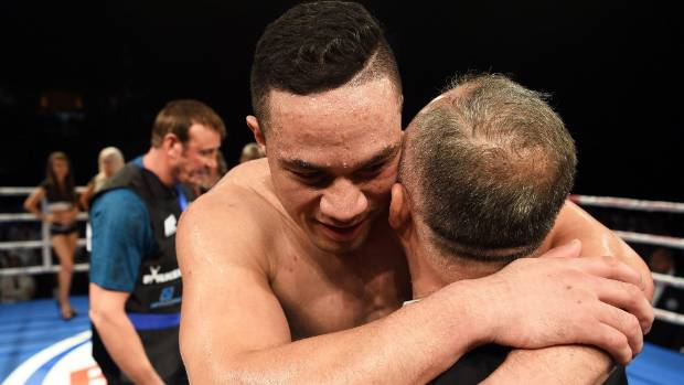 New Zealand heavyweight boxer Joseph Parker hugs his dad after defeating Daniel Martz at Claudelands Arena in Hamilton ...