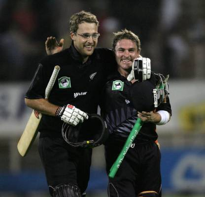 Daniel Vettori and Brendon McCullum leave the field after getting the final runs to bet Australia in the Chappell-Hadlee ...