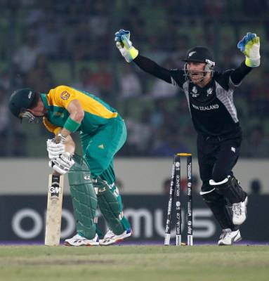 South Africa's Johan Botha is bowled by Jacob Oram as wicket keeper Brendon McCullum celebrates during their Cricket ...
