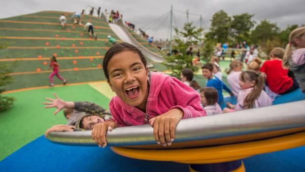 Tamara Henhan, 7, took a spin on the just-opened Margaret Mahy Family Playground.