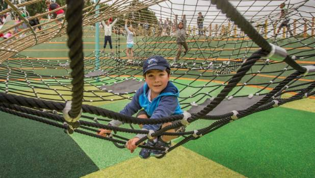 Alex Horn, 7, tries the spider's web.