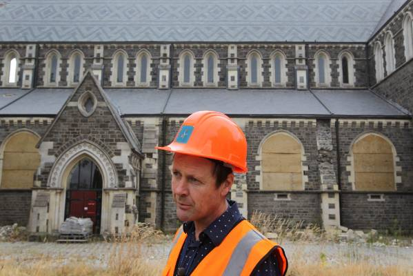 Engineer John Hare on the south side of the building, during the process in 2012 to assess the building's state.