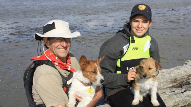 Guide Will Parsons, left, and tourist Livia Oberholzer, with dogs Gus and Vix.