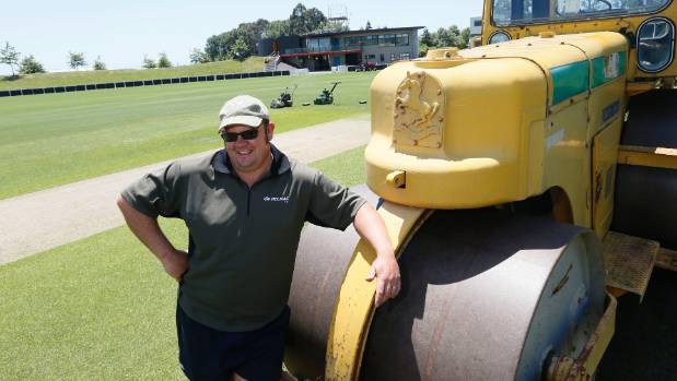 Dan Hooper uses a very heavy roller to prepare the wicket for the one day international cricket games between the Black ...