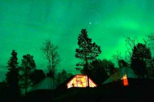 The Aurora Borealis seen over a mountain camp north of the Arctic Circle, near the village of Mestervik, Norway.