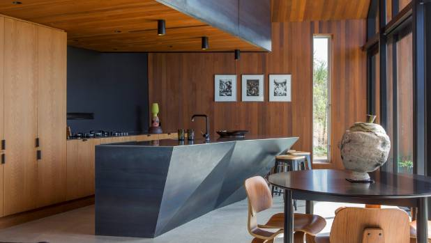 Timber veneer and blue steel combine in the Grand Designs Pakiri house designed by architect Paul Clarke. Black accents ...