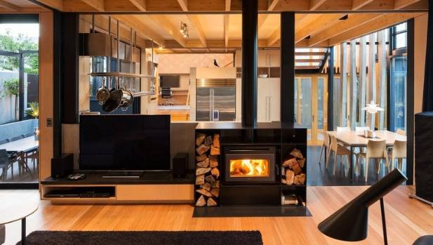 The interior of the Boat Sheds house by SGA with Rachael Rush features a split-level family living space, natural ...