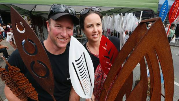 Brendon and Jane Harley with some of the metal sculptures at their Richmond Market Day stall.