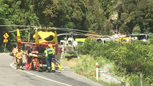 Paramedics load patients into helicopters at the scene of a bus crash in Otira Gorge.