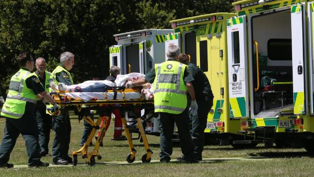 Ambulances at Hagley Park in Christchurch take patients injured in a crash near Arthur's Pass.