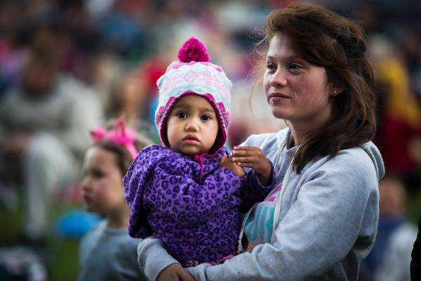 Thousands turned out for the entertaining party in Palmerston North. Cindy Napier with Thea Cirimakaumoli.