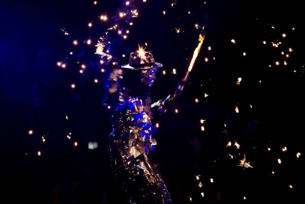 A masked performer from Highly Flammable dancers with a couple of flame throwers during Palmerston North's New Year's ...