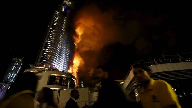 The flames rose up the side of the 63-storey building.