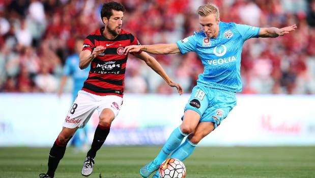 Adelaide's James Jeggo of competes with Andreu of the Wanderers.