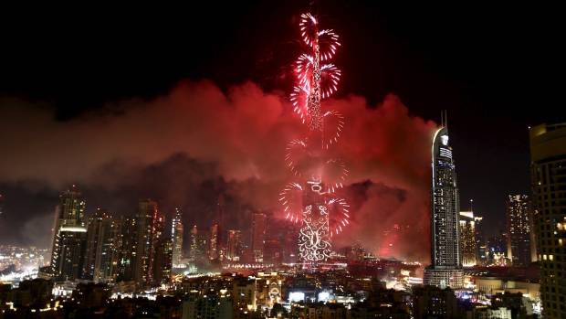 Fireworks marked the start of 2016, as the blaze continued to burn.