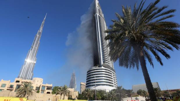 Plumes of smoke continue to rise from the 63-storey Address Downtown Dubai hotel, a day after it caught fire.