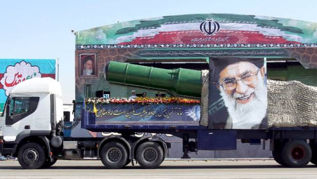 A military truck carries a missile and a picture of Iran's Supreme Leader Ayatollah Ali Khamenei during a parade marking ...