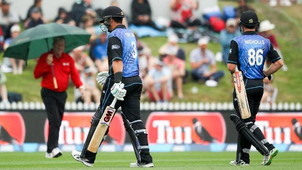 Ross Taylor and Henry Nicholls leave the field due to rain after just nine overs of action in the fourth ODI against Sri ...