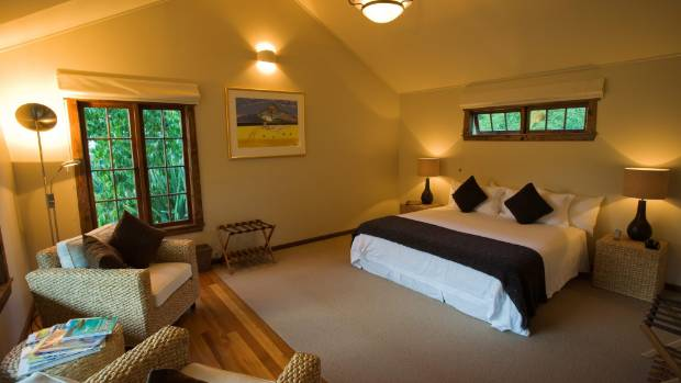 A cottage suite at the Owen River Lodge with views of the Kahurangi National Park and Owen River.
