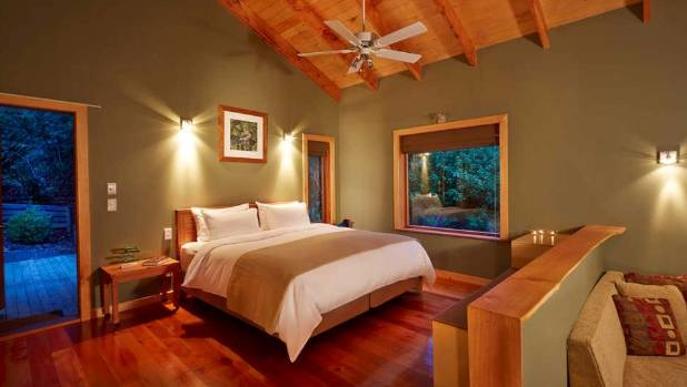 A bedroom in the bush lodge at The Resurgence luxury eco lodge in the Riwaka Valley.