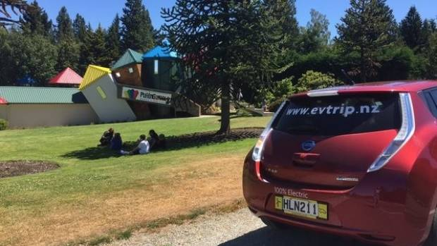 Martin Kane's Nissan Leaf electric car stops at Wanaka's Puzzling World funhouse on a trip to Greymouth