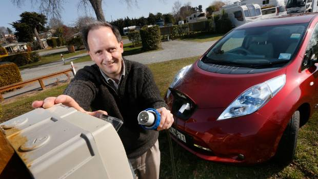 Martin Kane prepares to charge his Nissan Leaf at the Timaru Top 10 Holiday Park in August.