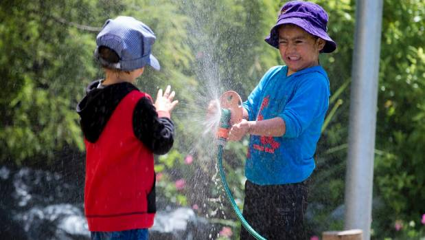 Sprinklers are tons of fun in summer - but watch out for the snaking hose!