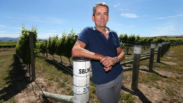 International Sauvignon Blanc Celebration organising committee chairman Patrick Materman stands beside some of the ...