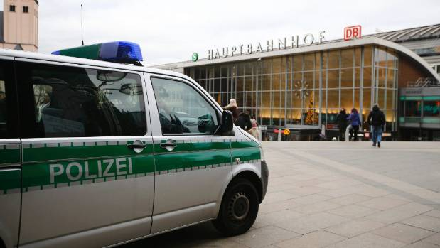 A police vehicle patrols at the main square and in front of the central railway station in Cologne after the attacks.