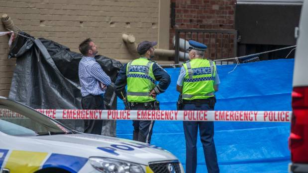 Police cordon an area on Eden Crescent, Auckland, after a person fell to their death.