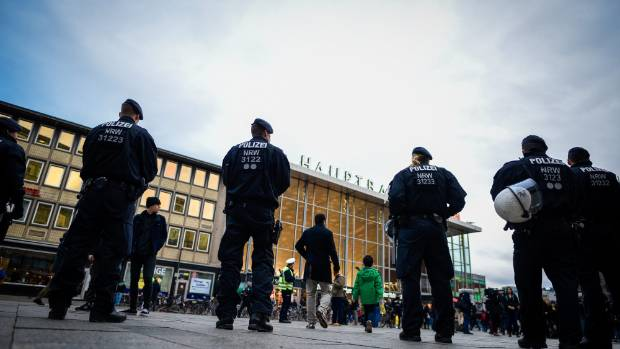 Police stand guard at Cologne's Hauptbahnhof main railway station.