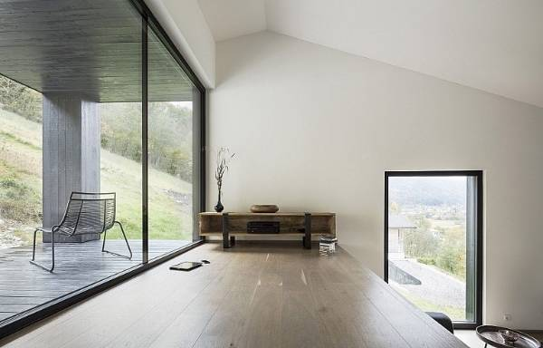 The house is built over three levels and features a simple, pared-back interior.
