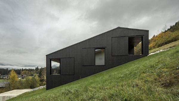 The asymmetrical roof follows the gradient of the slope, enhancing the sense that the house might slide down the hill at ...