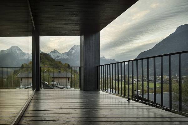 The EFH Groth house in Lofer, Austria, designed by LP Architektur, sits on a steep slope that provides spectacular ...