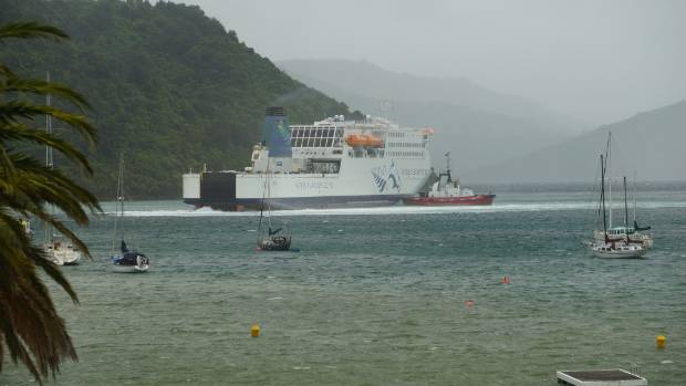 The Interislander ferry is towed into port in Picton.