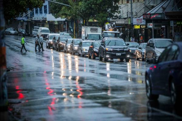 Traffic on Auckland's Karangahape Rd during the summer downpour.
