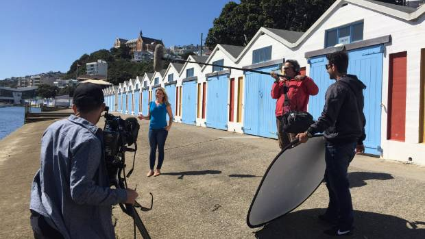 Australian Explore TV presenter Caty Price during a shoot at the Oriental Bay Boatshed in Wellington for an episode ...