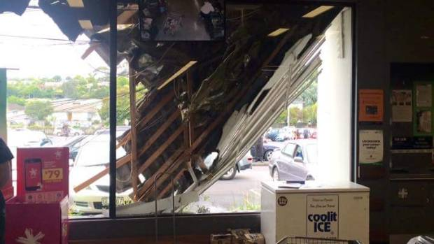 The inside of the Countdown store, showing the damage